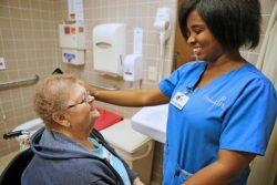 A member receives personal care at a Senior LIFE Health and Wellness Center.